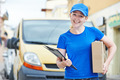 delivery woman with package outdoors - PhotoDune Item for Sale