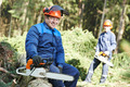 Lumberjack worker with chainsaw in the forest - PhotoDune Item for Sale