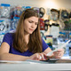 Worried Woman Checking Bills And Invoices With Calculator - PhotoDune Item for Sale