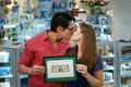 Happy Shop Owners kissing And Showing First Dollar - PhotoDune Item for Sale