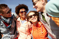 smiling friends in sunglasses laughing on street - PhotoDune Item for Sale