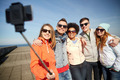 smiling friends taking selfie with smartphone - PhotoDune Item for Sale
