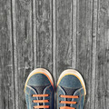 Hipster sneakers on a light wooden background - PhotoDune Item for Sale