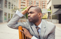 Stressed young businessman sitting outside corporate office - PhotoDune Item for Sale