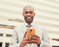 happy, cheerful man excited by what he sees on cell phone - PhotoDune Item for Sale
