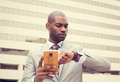 businessman texting on mobile phone and looking at his watch - PhotoDune Item for Sale