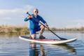 Senior male on SUP paddleboard - PhotoDune Item for Sale