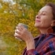 Woman Of Middle Age With Mug Of Cocoa In Autumn - VideoHive Item for Sale