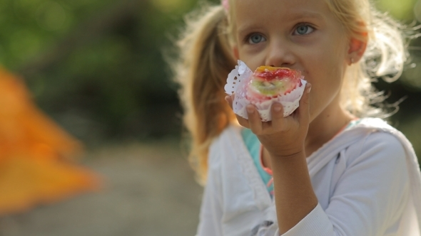 Amazing Little Girl With Blue Eyes Eating Cake