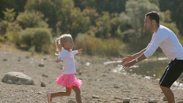Little Blond Girl Running Toward Father And He