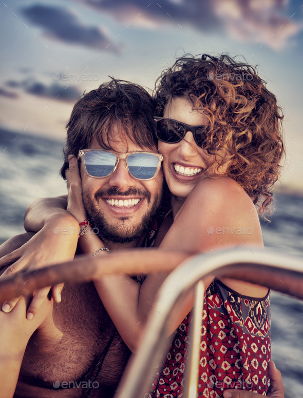 Happy lovers on sailboat