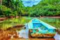 Old boat in tropical river - PhotoDune Item for Sale