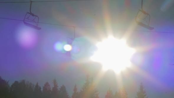 Ski Lift On The Sun Background