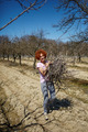 Woman spring cleaning the orchard - PhotoDune Item for Sale