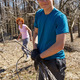 Teenager boy and his mother spring cleaning the orchard - PhotoDune Item for Sale