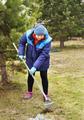 Woman gardener cleans a garden in spring - PhotoDune Item for Sale