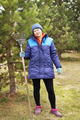 Woman gardener stands with a rake in the garden - PhotoDune Item for Sale