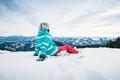 Snowboarder sitting on snow - PhotoDune Item for Sale