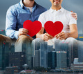close up of happy gay male couple with red hearts - PhotoDune Item for Sale