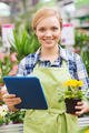 happy woman with tablet pc in greenhouse - PhotoDune Item for Sale