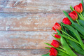 close up of red tulips on wooden background - PhotoDune Item for Sale