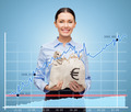 businesswoman holding money bags with euro - PhotoDune Item for Sale