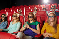 happy woman with smartphone in 3d movie theater - PhotoDune Item for Sale
