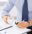 businessman drinking coffee in office - PhotoDune Item for Sale