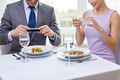 close up of couple with smartphones at restaurant - PhotoDune Item for Sale