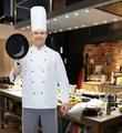 happy male chef cook holding frying pan - PhotoDune Item for Sale