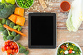 close up of blank tablet pc screen and vegetables - PhotoDune Item for Sale
