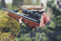 soldier or hunter shooting with gun in forest - PhotoDune Item for Sale