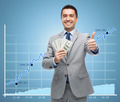 smiling businessman with money showing thumbs up - PhotoDune Item for Sale
