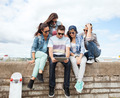 group of teenagers looking at tablet pc - PhotoDune Item for Sale