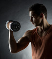 young man with dumbbell - PhotoDune Item for Sale