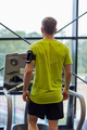 man exercising on treadmill in gym from back - PhotoDune Item for Sale