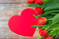 close up of red tulips and paper heart shape card - PhotoDune Item for Sale