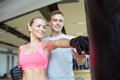 happy woman with personal trainer boxing in gym - PhotoDune Item for Sale