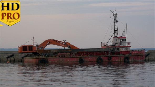 An Old Excavator on Dock on the Sea