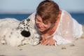 loving dog owner at beach - PhotoDune Item for Sale