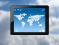 tablet pc with world map made of clouds - PhotoDune Item for Sale