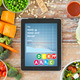 close up of tablet pc with chart and vegetables - PhotoDune Item for Sale