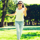 smiling young woman with sunglasses in park - PhotoDune Item for Sale