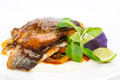 baked fish with vegetables and mushrooms in a restaurant - PhotoDune Item for Sale