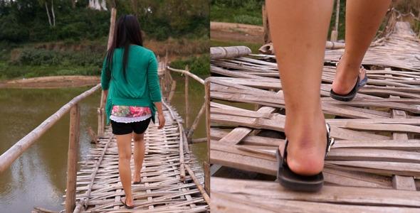 Asian Girl Walking On Bamboo Bridge