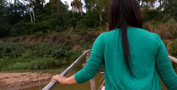 Girl Walking On Bamboo Bridge