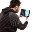 Man with a hand fracture and x-ray film - PhotoDune Item for Sale