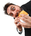 Young man while eating quickly a sandwich - PhotoDune Item for Sale