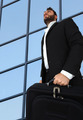 Businessman with briefcase over windows of skyscrapers. - PhotoDune Item for Sale