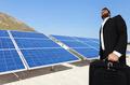 Businessman over big solar panels - PhotoDune Item for Sale